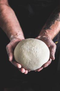person holding dough